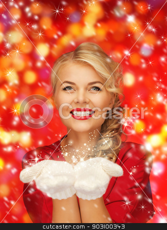 woman holding something on the palms stock photo, lovely woman in red dress and white mittens holding something on the palms by Syda Productions