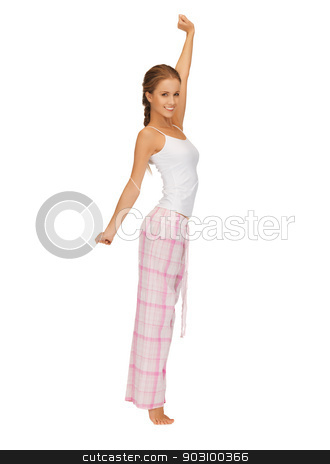 woman in pajamas doing morning exercise stock photo, picture of woman in pajamas doing morning exercise by Syda Productions