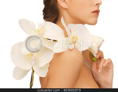 woman's shoulder and hands holding orchid flower stock photo, closeup picture of woman's shoulder and hands holding orchid flower by Syda Productions