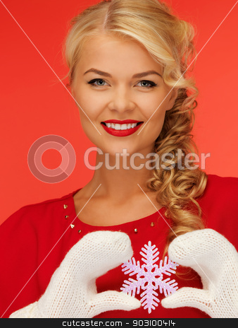 woman in mittens and red dress with snowflake stock photo, picture of lovely woman in mittens and red dress with snowflake by Syda Productions