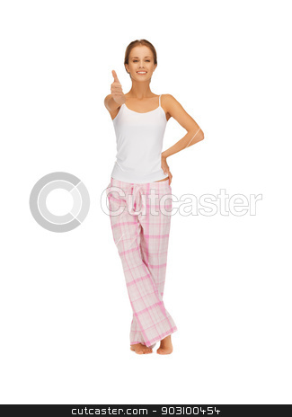 woman in cotton pajamas showing thumbs up stock photo, picture of woman in cotton pajamas showing thumbs up by Syda Productions