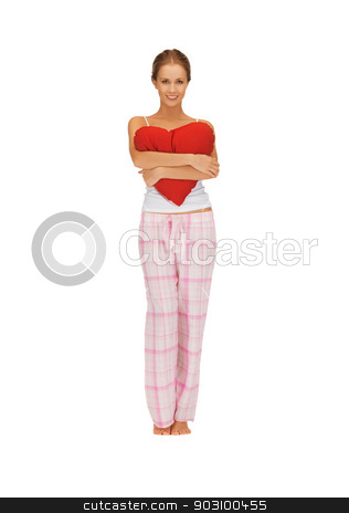 woman in cotton pajamas with big heart stock photo, picture of woman in cotton pajamas with big heart by Syda Productions
