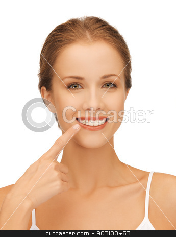 beautiful woman pointing to teeth stock photo, picture of beautiful woman pointing to teeth by Syda Productions