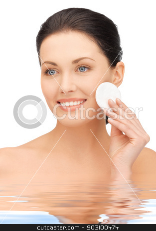 beautiful woman with cotton pad in water stock photo, bright picture of beautiful woman with cotton pad in water by Syda Productions
