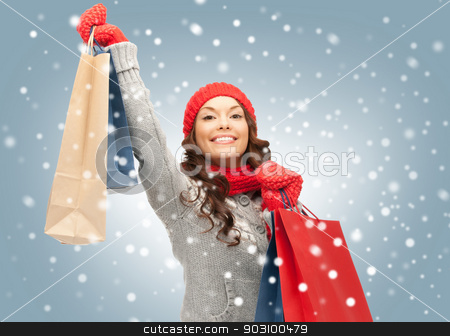 shopper stock photo, picture of lovely woman with shopping bags by Syda Productions