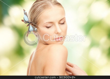 woman with butterflies in hair stock photo, picture of lovely woman with butterflies in hair by Syda Productions