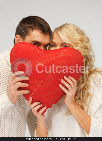 family couple in a sweaters with heart stock photo, picture of family couple in a sweaters with heart by Syda Productions