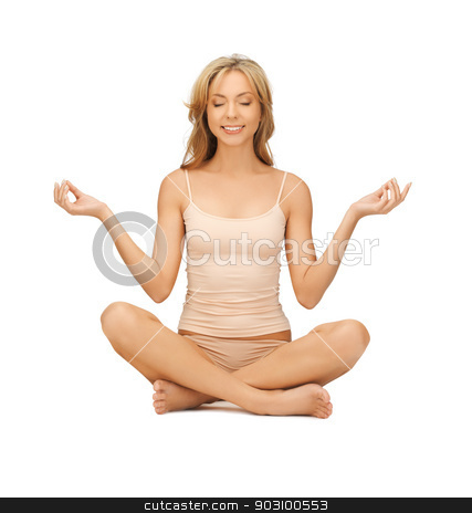 woman practicing yoga lotus pose stock photo, sporty woman in cotton undrewear practicing yoga lotus pose by Syda Productions