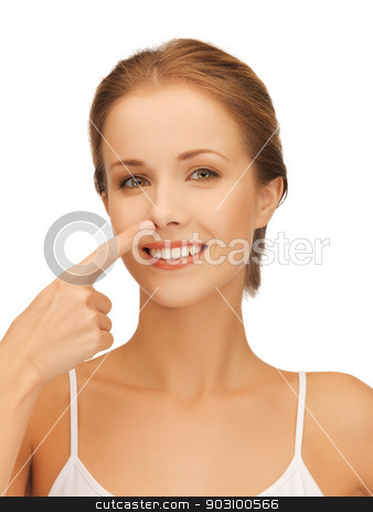 beautiful woman pointing to nose stock photo, picture of beautiful woman pointing to nose by Syda Productions
