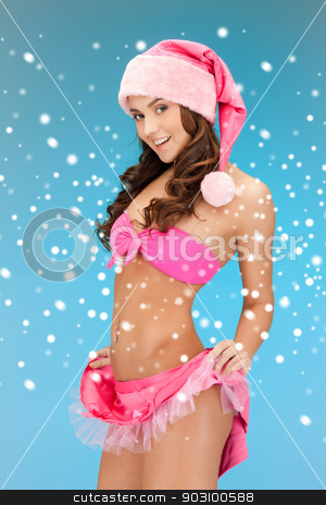cheerful santa helper girl in lingerie with snow stock photo, picture of cheerful santa helper girl in lingerie with snow by Syda Productions