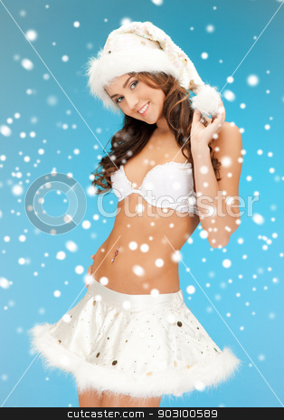 cheerful santa helper girl in lingerie with snow stock photo, picture of cheerful santa helper girl in lingerie with snow by Syda Productions