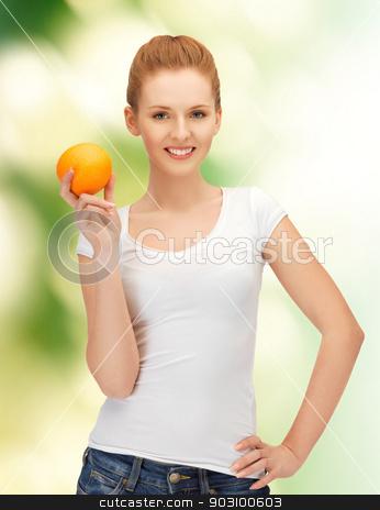 teenage girl with orange stock photo, happy teenage girl with orange over green by Syda Productions
