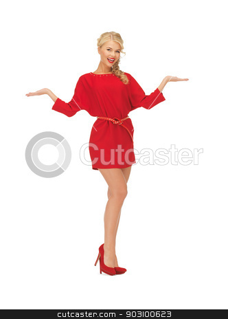 woman showing something on the palms stock photo, lovely woman in dress showing something on the palms of her hands by Syda Productions