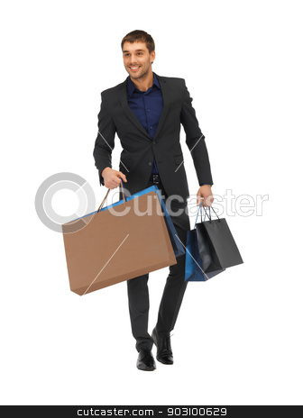 handsome man in suit with shopping bags stock photo, picture of handsome man in suit with shopping bags. by Syda Productions