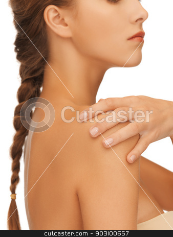 woman's hand and shoulder stock photo, closeup picture of woman's hand and shoulder by Syda Productions