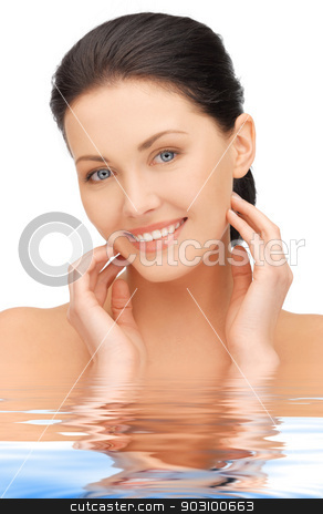face and hands of beautiful woman in water stock photo, bright closeup portrait picture of beautiful woman in water by Syda Productions