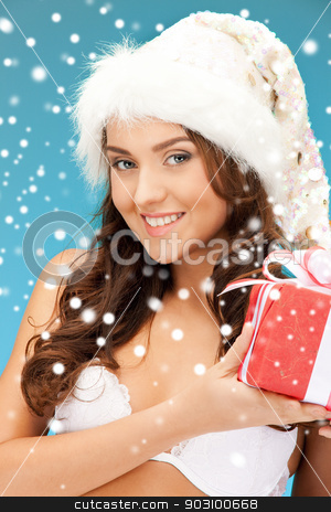 santa helper girl with gift box stock photo, picture of cheerful santa helper girl with gift box by Syda Productions