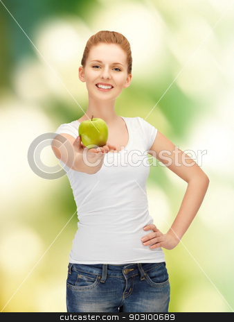 teenage girl with green apple stock photo, picture of happy teenage girl with green apple. by Syda Productions