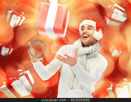handsome man in christmas hat stock photo, bright picture of handsome man in christmas hat. by Syda Productions