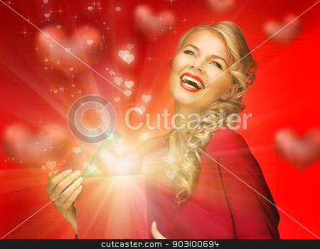 lovely woman in red dress with valentine gift box stock photo, picture of lovely woman in red dress with valentine gift box by Syda Productions