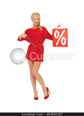 woman with shopping bag showing thumbs up stock photo, picture of woman in red dress with shopping bag showing thumbs up by Syda Productions