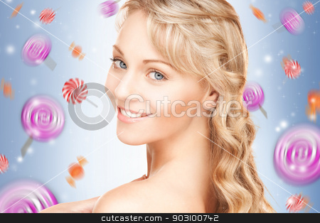 happy teenage girl with lollipops stock photo, bright closeup portrait picture of happy teenage girl with lollipops by Syda Productions