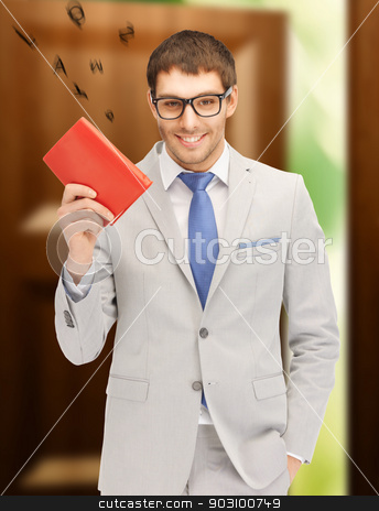 happy man with book stock photo, bright picture of happy man with book by Syda Productions