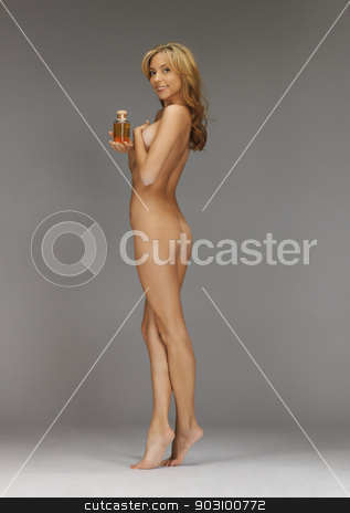 healthy naked woman with oil bottle stock photo, bright picture of healthy naked woman with oil bottle by Syda Productions