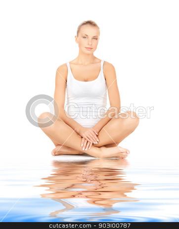 beautiful woman in cotton undrewear on white sand stock photo, picture of beautiful woman in cotton undrewear on white sand by Syda Productions