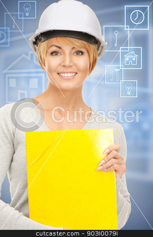 contractor in helmet stock photo, bright picture of female contractor in helmet over blue. by Syda Productions