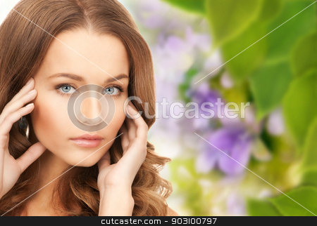 lovely woman stock photo, bright picture of lovely woman over floral background by Syda Productions