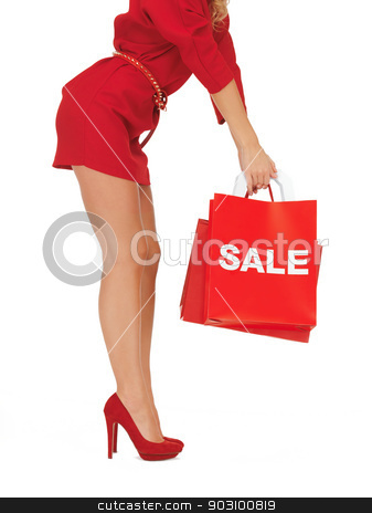 woman on high heels holding shopping bag stock photo, closeup picture of woman on high heels holding shopping bag by Syda Productions