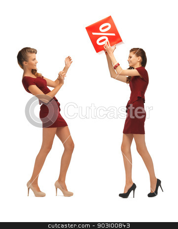 two teenage girls in red dresses with percent sign stock photo, picture of two teenage girls in red dresses with percent sign by Syda Productions