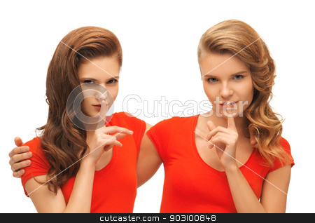 two teenage girls showing hush gesture stock photo, picture of two teenage girls showing hush gesture by Syda Productions