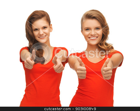 wo teenage girls in red t-shirts showing thumbs up stock photo, picture of two teenage girls in red t-shirts showing thumbs up by Syda Productions