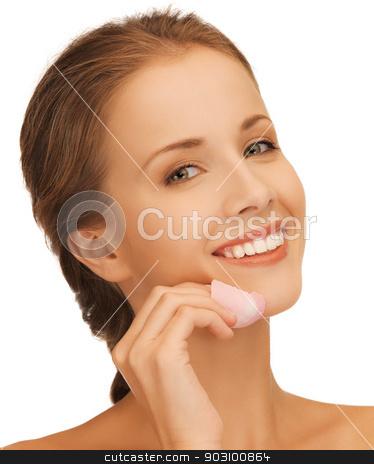 beautiful woman with rose petal stock photo, picture of beautiful woman with rose petal by Syda Productions
