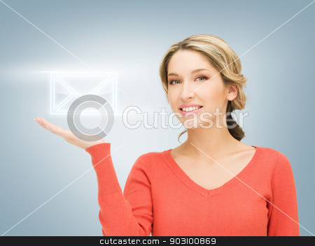 virtual envelope on the palm stock photo, smiling woman showing virtual envelope on the palm of her hand by Syda Productions