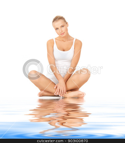 beautiful woman in cotton undrewear on white sand stock photo, picture of beautiful woman in cotton undrewear on white sand by Syda Productions