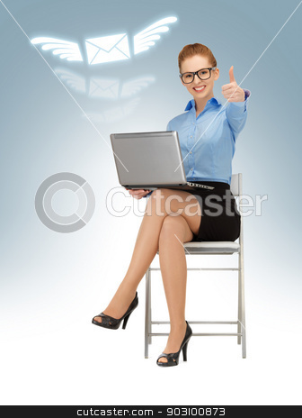 thumbs up stock photo, business woman with laptop showing thumbs up by Syda Productions
