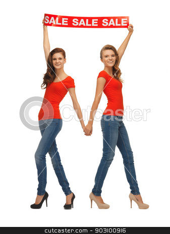 two teenage girls with sale sign stock photo, two teenage girls in red t-shirts with sale sign by Syda Productions