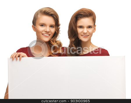 two teenage girls in red dresses with blank board stock photo, picture of two teenage girls in red dresses with blank board by Syda Productions