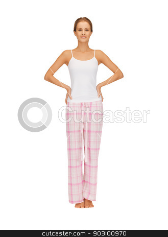 happy and smiling woman in cotton pajamas stock photo, bright picture of happy and smiling woman in cotton pajamas by Syda Productions