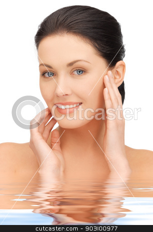 beautiful woman in water stock photo, bright closeup portrait picture of beautiful woman in water by Syda Productions