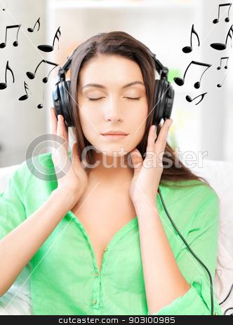 happy teenage girl in big headphones stock photo, picture of happy teenage girl in big headphones by Syda Productions