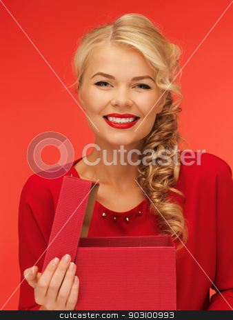 lovely woman in red dress with opened gift box stock photo, picture of lovely woman in red dress with opened gift box by Syda Productions