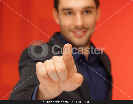 handsome man in suit pressing virtual button stock photo, bright picture of handsome man in suit pressing virtual button. by Syda Productions
