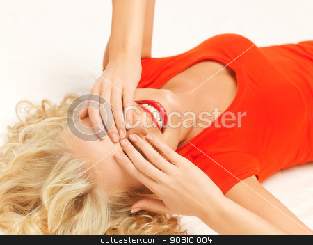 lying pensive beautiful woman with closed eyes stock photo, bright picture of lying pensive beautiful woman with closed eyes by Syda Productions