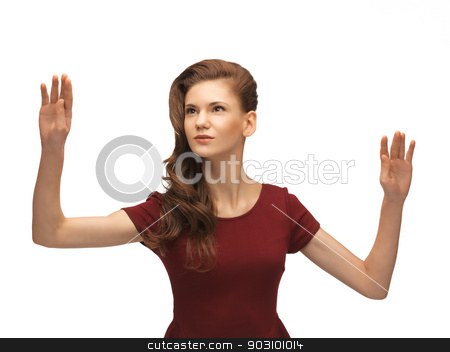 teenage girl working with something imaginary stock photo, picture of teenage girl in red dress working with something imaginary by Syda Productions