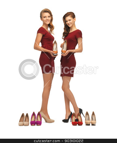 two lovely teenage girls in red dresses with shoes stock photo, picture of two lovely teenage girls in red dresses with shoes by Syda Productions