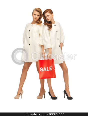 teenage girls in white coats with shopping bags stock photo, picture of two teenage girls in white coats with shopping bags by Syda Productions